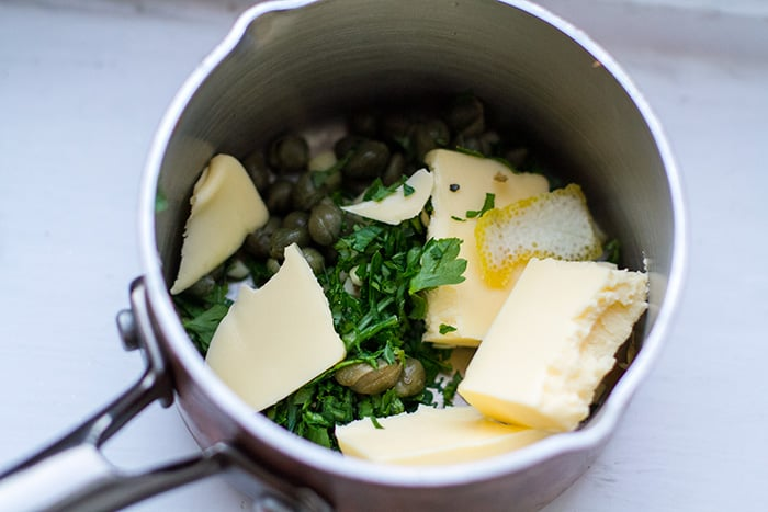 Making caper garlic butter sauce for the vegetables