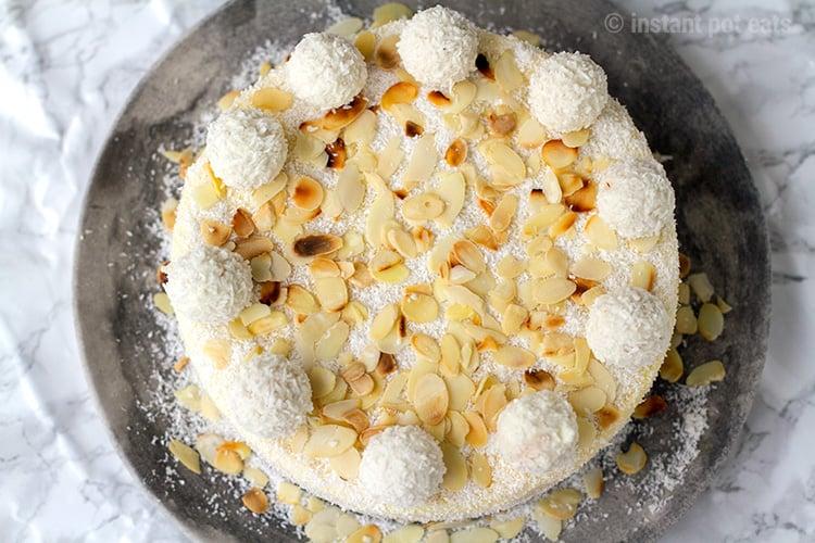 Raffaello cheesecake decorated with whole Raffellos