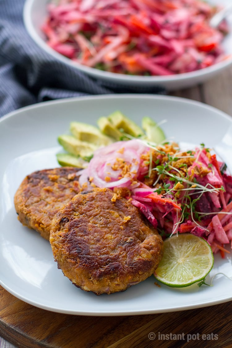 Vegan burgers with beet slaw, avocado and pickled onions