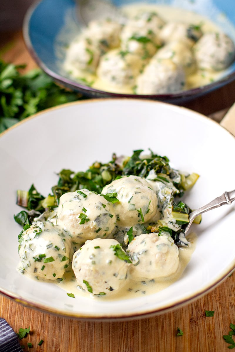 Pressure cooker chicken meatballs with Alfredo sauce and sautéed greens