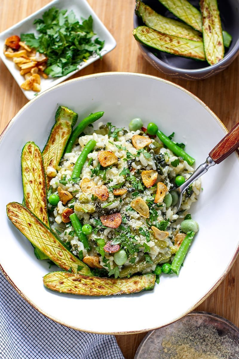 Pressure cooker vegan risotto with green veggies and fried garlic