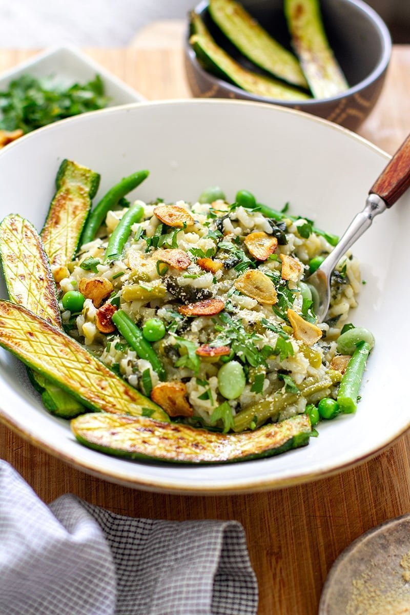 Instant Pot vegan risotto with green vegetables, zucchini and fried garlic