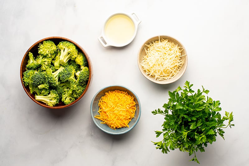 Finishing ingredients for cheesy chicken rice casserole in Instant Pot