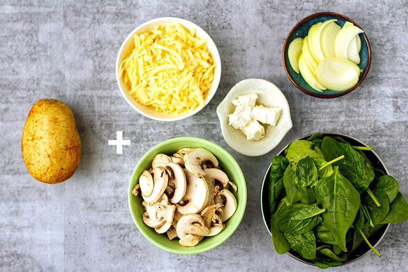 Ingredients for mushroom, spinach and feta stuffed potatoes