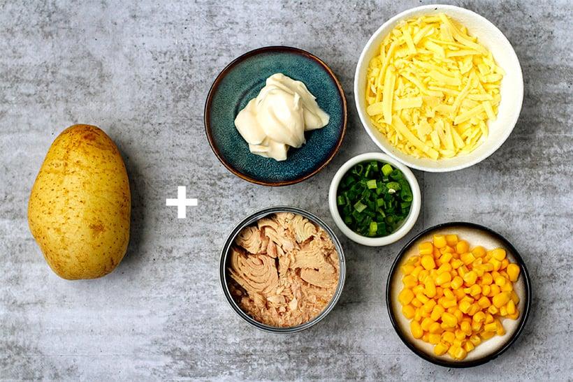 Stuffed potatoes with tuna, mayo, corn and cheese